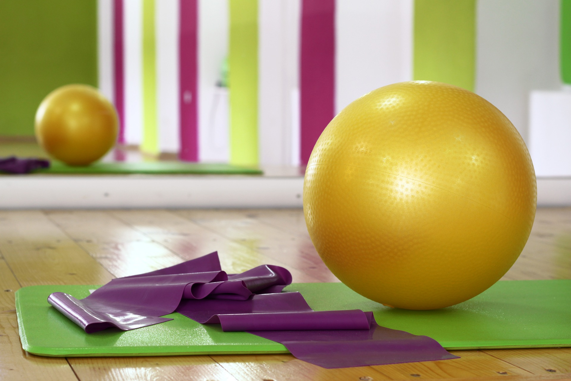 pilates equipment gold swiss ball and stretch bands