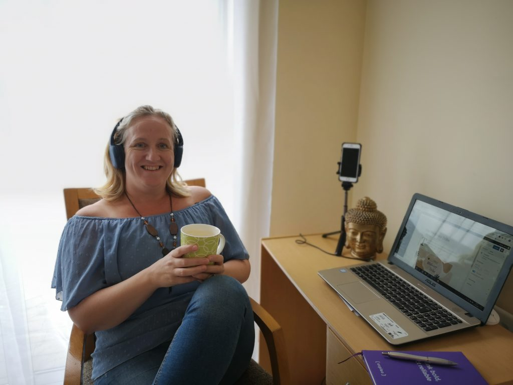 Andrea O'Grady Drinking Tea during Wellness Tribe Coffee hour